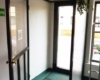 Aluminium Glas 90 Grad Eck Windfang im Innenbereich 2 Fach Isolierverglasung Farbe Braun RAL 8019 für Arztpraxen & Gewerbe & Cafés & Restaurants