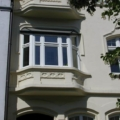 Balkonverglasung als Holz Erkerfenster