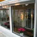 Balkonverglasung als Wintergarten mit Dachschiebefenster Aluminium Glas