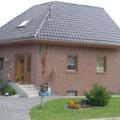 Holz Haustür mit Seitenteil Links mit Dreiecks Verglasung und Messing Stoßgriff
