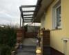 Aluminium Terrassenüberdachung Pultdach Ausführung Farbe Pulverbeschichtet TIGER Drylac® 29/70786 Dachverglasung 10mm Sicherheitsglas 0,76 Folie 4 Stützen auf Brüstungsmauerwerk montiert