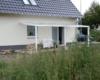 Aluminium Terrassenüberdachung als Pultdach Ausführung Farbe Weiß mit glasteilender Sprosse 3-fach Sonnenschutz Stegplatte 30 mm 3 Stützen