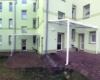 Aluminium Terrassenüberdachung als Pultdach Ausführung Farbe Weiß mit glasteilender Sprosse Sicherheitsdachverglasung 10 mm  0,76 Folie 2 Stützen