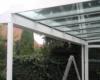 Aluminium Terrassenüberdachung als Pultdach Ausführung Farbe Weiß mit Terrassendach Windschutz Seitenelement  & Oberlicht mit Schräge Sicherheitsdachverglasung als 2-Fachvergalsung 0,76 Folie