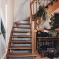 Massivholzwangentreppe Buche 1/8 gewendelt Wand seitig eingestemmt Geländer seitig aufgesattelt Handlauf 40 X 80 mm & runde Geländerstäbe & Pfosten & Brüstungsgeländer