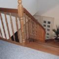 Massivholzwangentreppe Buche 1/4 gewendelt Wand seitig eingestemmt Geländer seitig aufgesattelt  Handlauf 40 X 80 mm & gedrechselte Geländerstäbe & Pfosten & Brüstungsgeländer