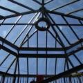 Holz-Aluminium Wintergarten als Sonderkonstruktion mit Sonnenschutzglas Dark Blue mit Dachkuppel komplett verglast.