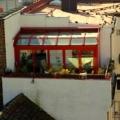 Holz-Aluminium Wintergarten mit Faltanlage und Seitenverglasung Farbe RAL 3000 Feuerwehrrot 2-Fach Verglasung 10 mm Sicherheitsglas & Erhard Wintergarten HS